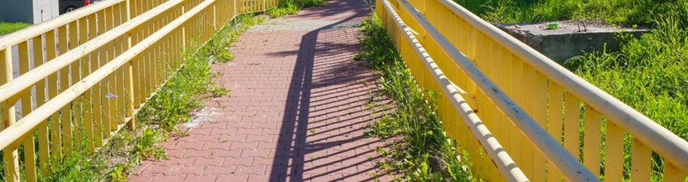 Ascending footpath with yellow metal barriers